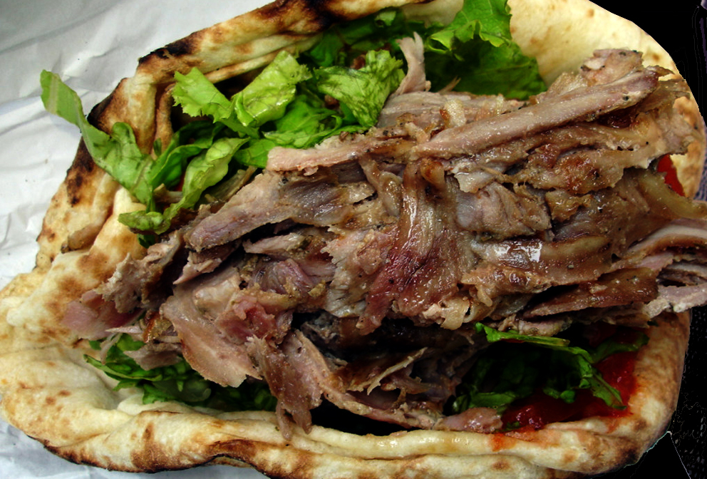 Kebab meat sliced from the cylinder, lettuce, tomato, cabbage, onion, chillies and chilli sauce on a pita...yummy.