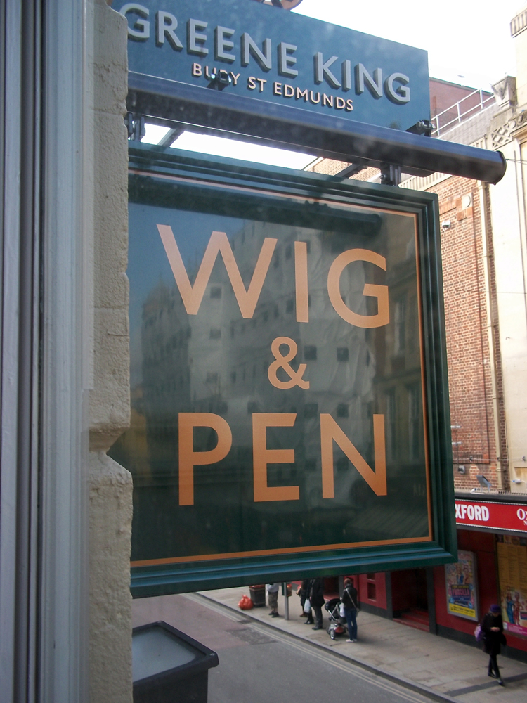 wig and pen oxford sign