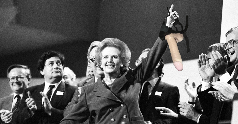 File photo of British Prime Minister Margaret Thatcher pointing skyward as she receives standing ovation at Conservative Party Conference