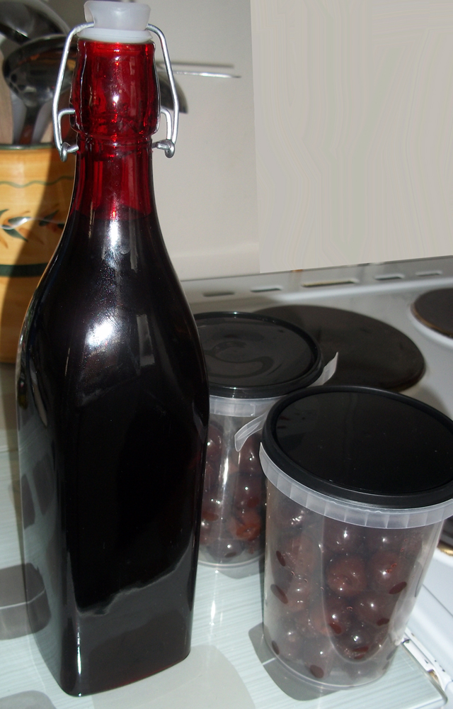 The cherries partitioned for for freezing and future use (found the bottle in a charity shop a few weeks ago)