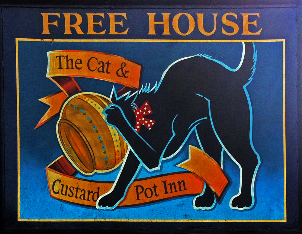 Cat and Custard Pot Shipton Moyne sign northside